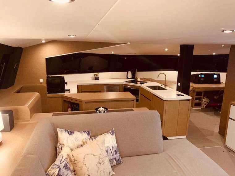 LA LINEA Yacht Charter - Contemporary, well equipped C-Shaped galley with a full bank of large glass windows that wrap the entire cabin.