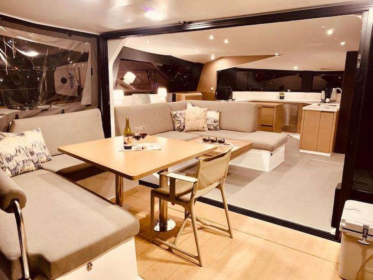 LA LINEA Yacht Charter - A wonderful cockpit/saloon area that brings the two together in massive outdoor living thanks to the glass sliding doors.