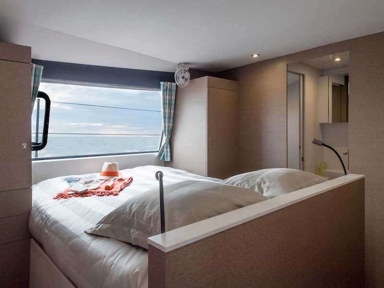 LA LINEA Yacht Charter - The Master Suite - what a place to relax and watch the world (or waves) go by through the large picture window.