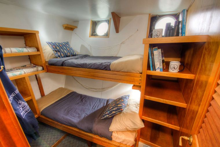 Snow Goose Yacht Charter - 1 of 6 cozy cabins. Each cabin offers a memory foam mattress, and individual outlets.