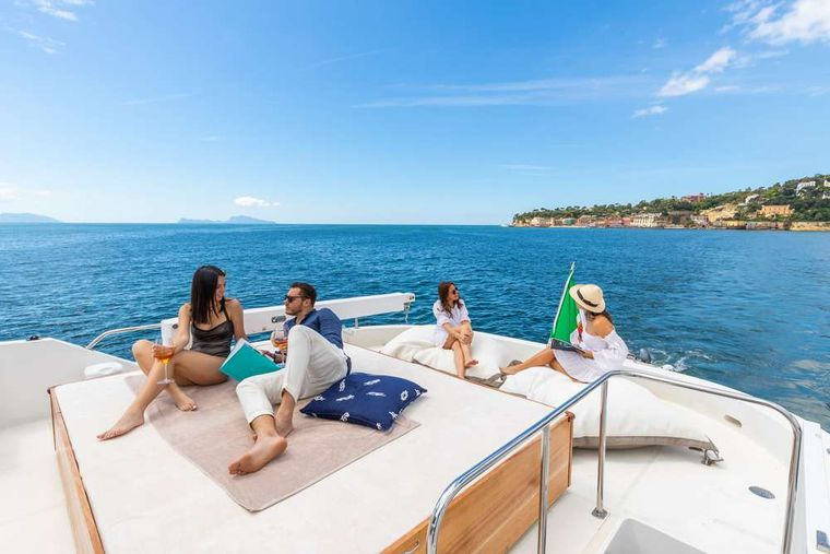 SHANGRA Yacht Charter - Guests sunbathing and gathering