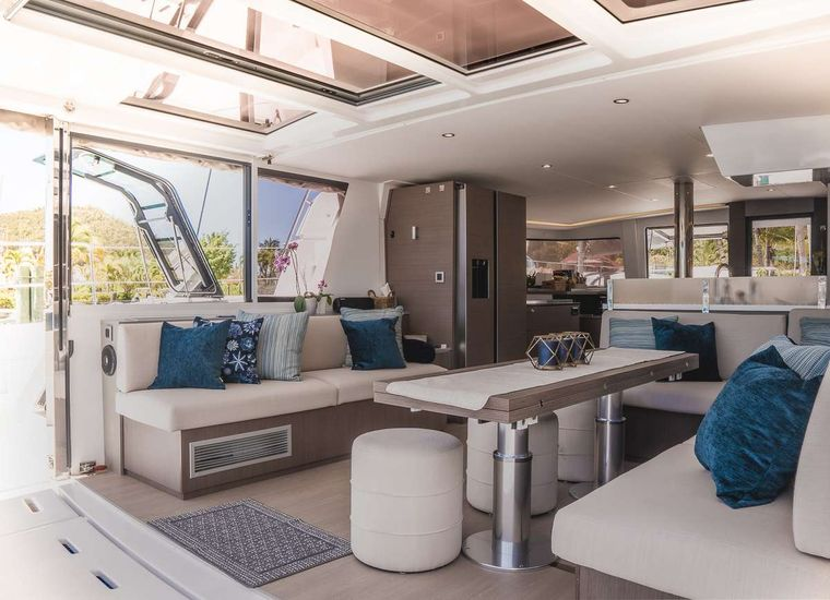 KORU Yacht Charter - Large fold out dining table comfortably seats up to 10