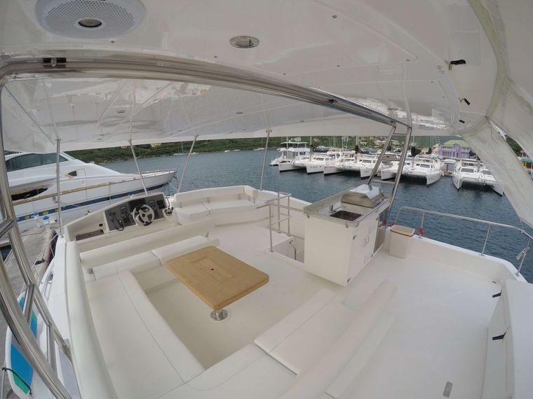 SOMEWHERE HOT Yacht Charter - Flybridge seating with new teak table