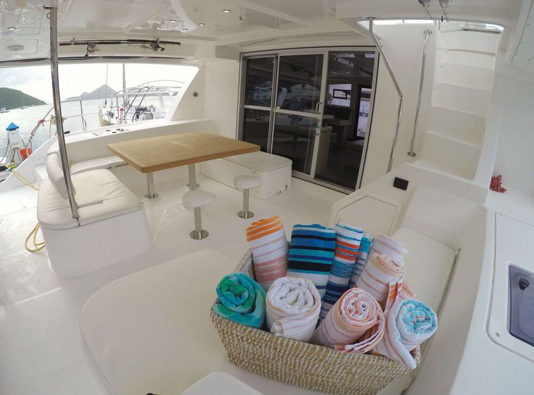 SOMEWHERE HOT Yacht Charter - Aft cockpit seating with new teak table