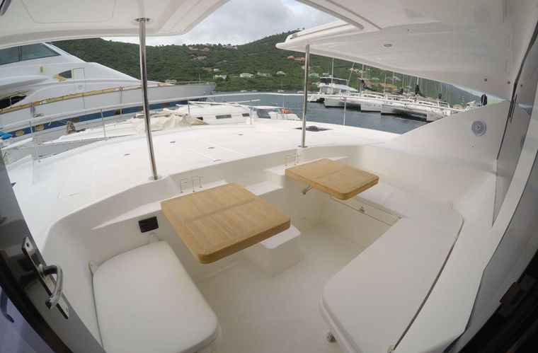 SOMEWHERE HOT Yacht Charter - New teak tables in the forward cockpit