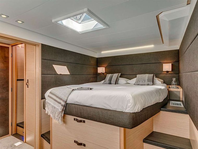 COLETTE Yacht Charter - Primary cabin with Queen berth, vanity and settee