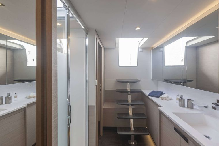ASTORIA Yacht Charter - Master bathroom with direct access to aft deck